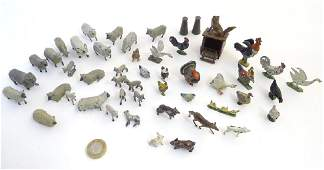 A quantity of lead toy farm animals sheep chickens