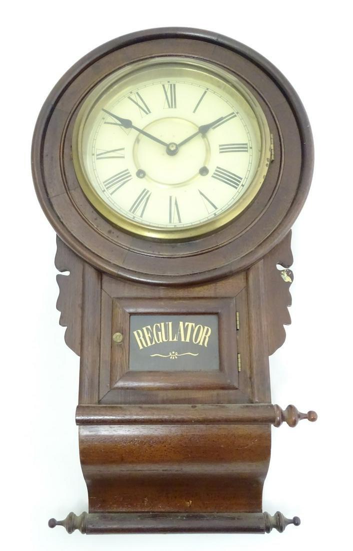 American Regulator wall clock: a walnut cased chisel