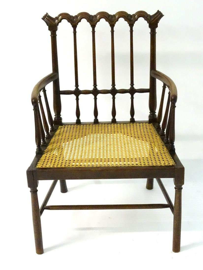 A 19thC mahogany open armchair with a repeating carved