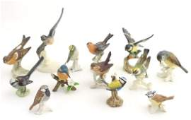 A large quantity of assorted porcelain models of birds