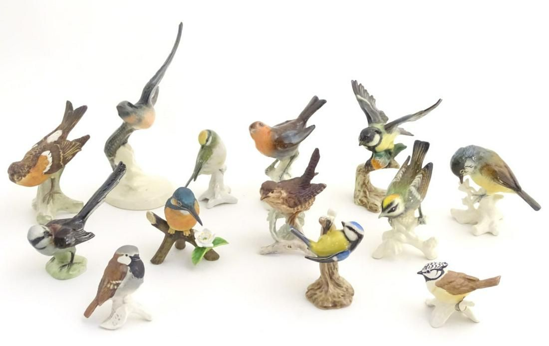 A large quantity of assorted porcelain models of birds,