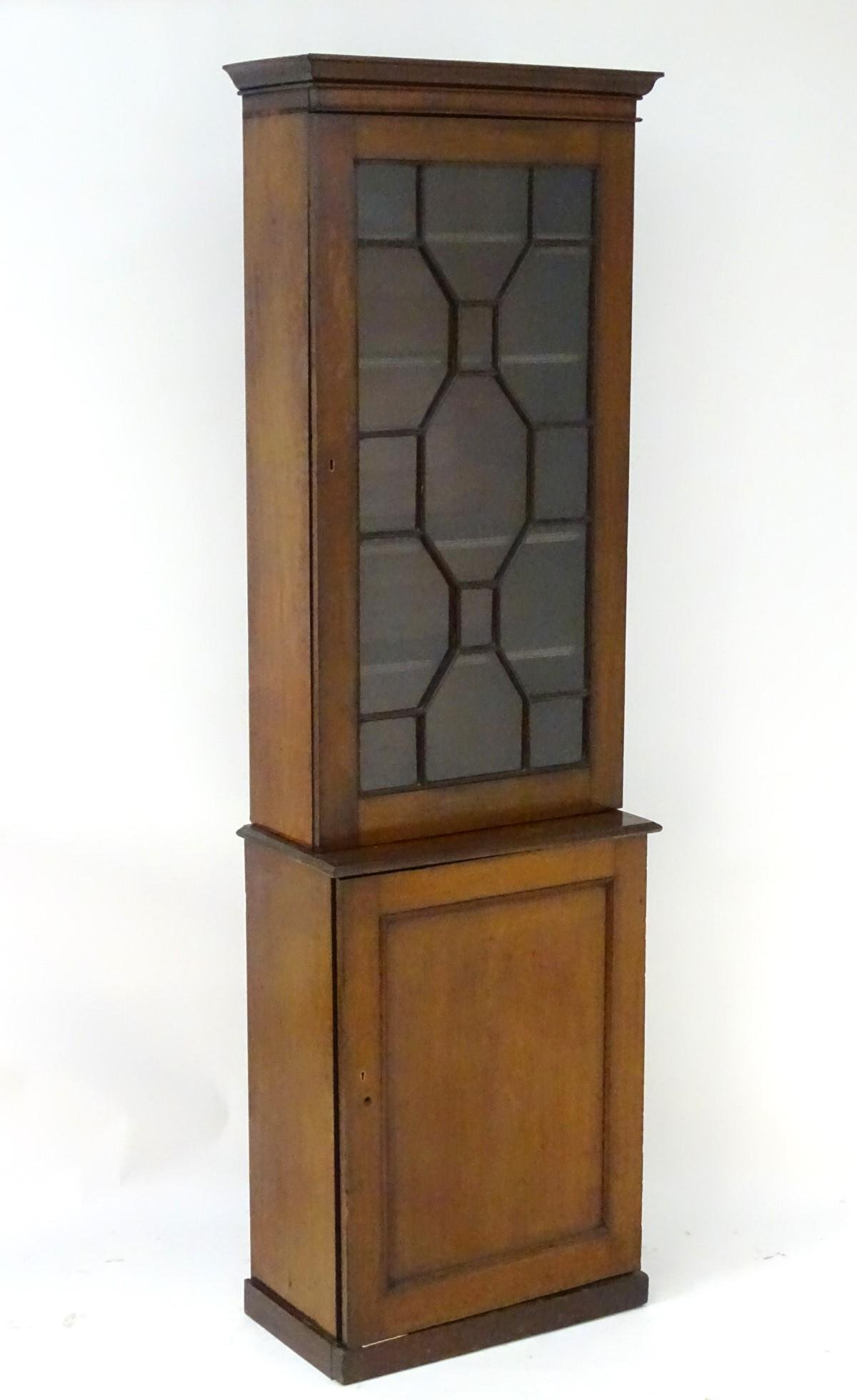A late 19thC / early 20thC mahogany cabinet with a