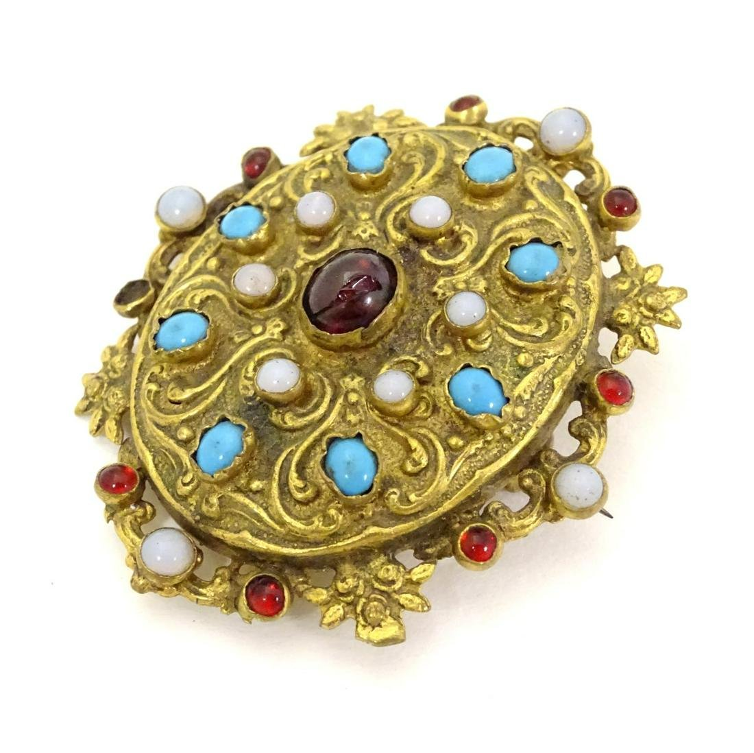 A gilt metal brooch set with moonstone turquoise and
