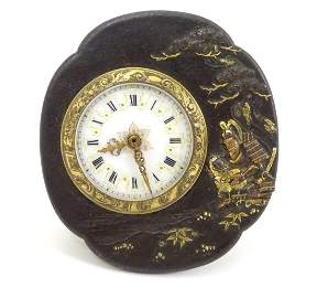 An unusual clock / timepiece, the enamelled dial and