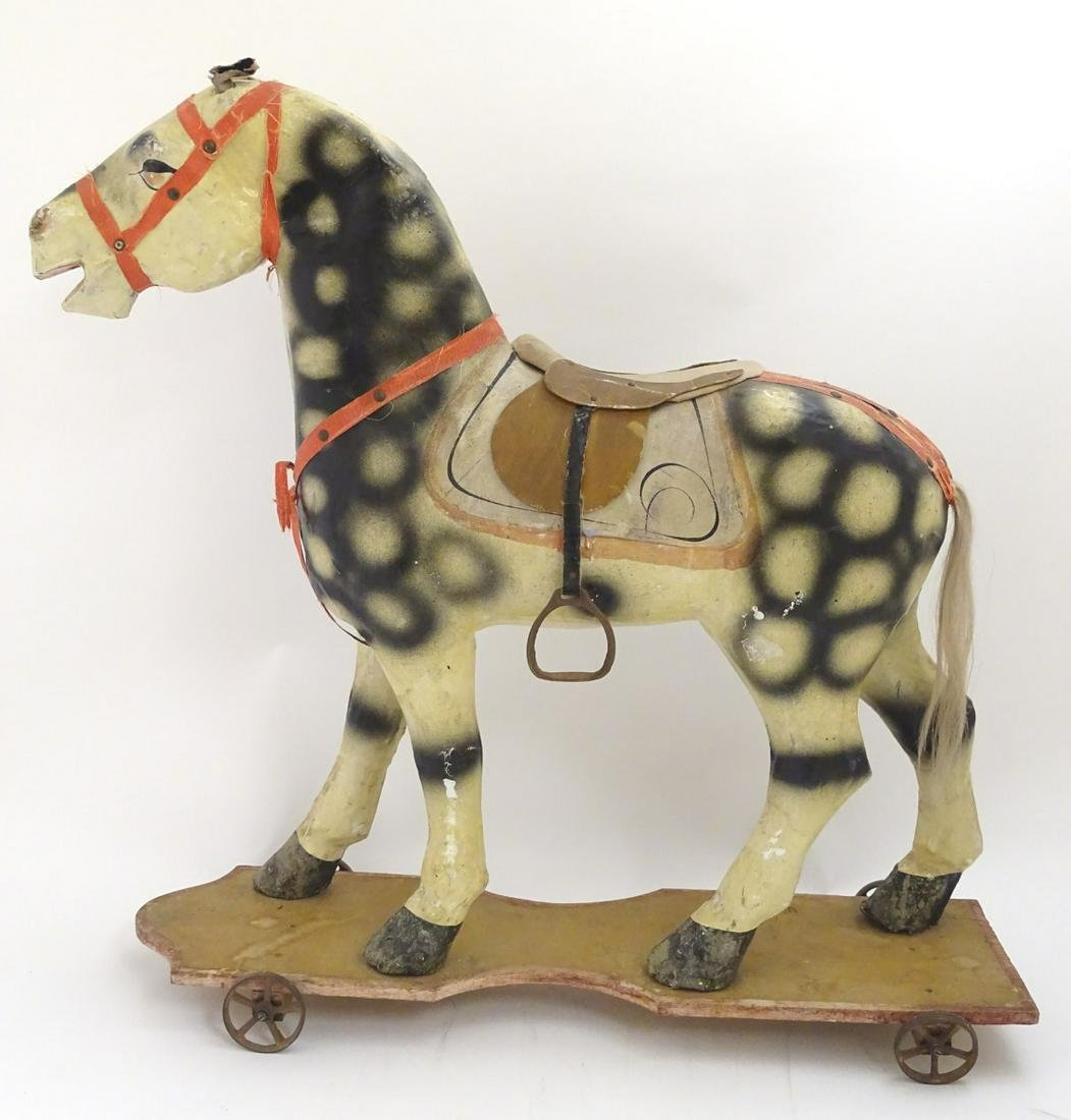 Toy: A 19thC Continental folk art papier mache pull