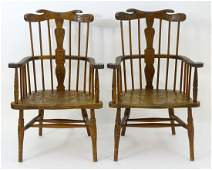A pair of 19thC comb back Windsor chairs with swept