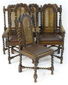 A set of six mid 20thC oak dining chairs with carved