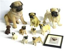 A quantity of assorted pug figurines, to include three