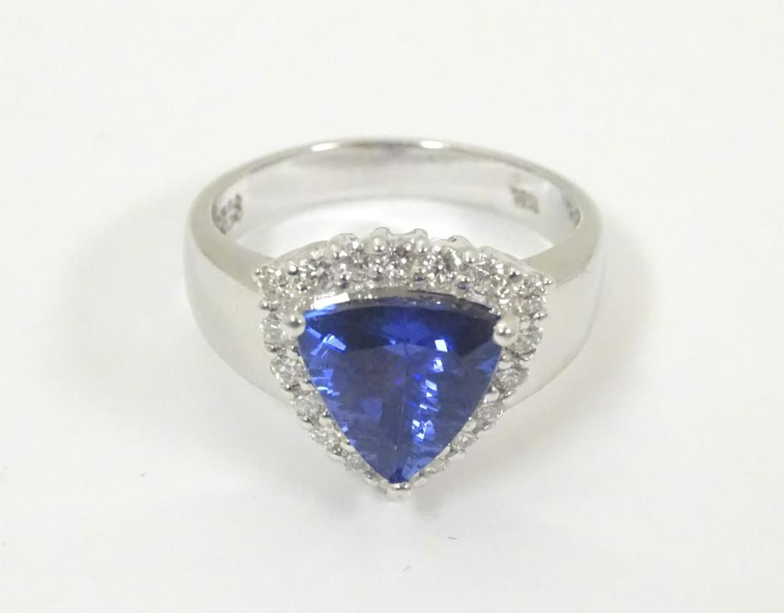 An 18ct white gold ring set with central iolite