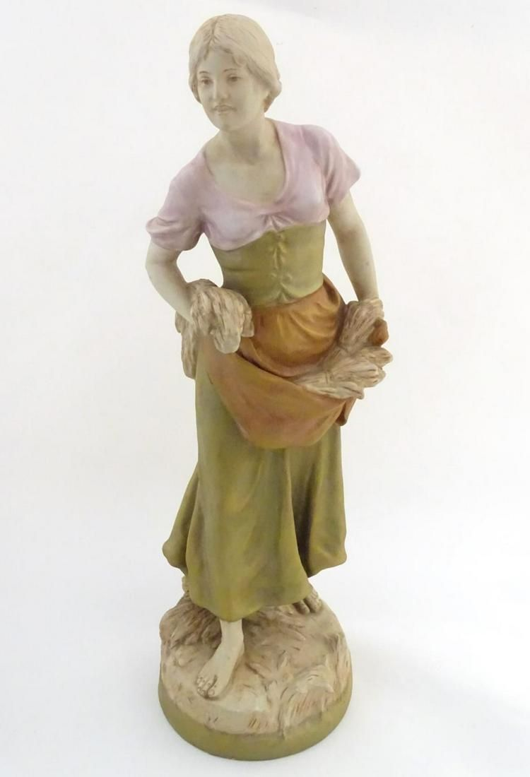 A large Royal Dux figurine modelled as a young woman /