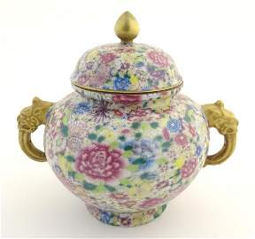 A Chinese famille rose millefiore twin handled pot and