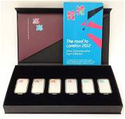 A boxed set of six 999 silver ingots commemorating