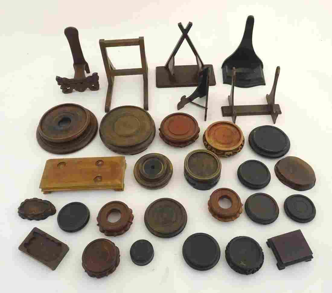 A quantity of assorted wooden plate stands, and vase /