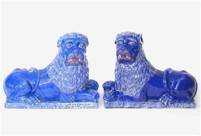 A pair of 19thC faience Luneville lions with a cobalt