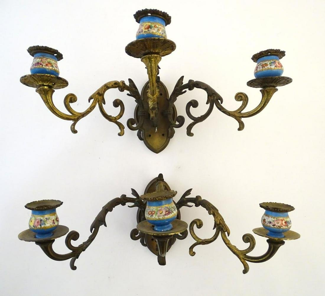 Lighting: a pair of early 20thC triple wall sconces, of