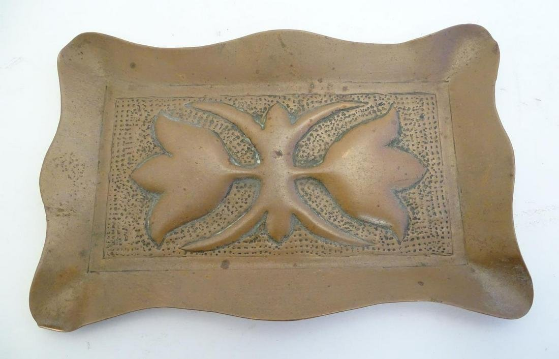 An early 20thC rectangular copper pin dish with a lobed