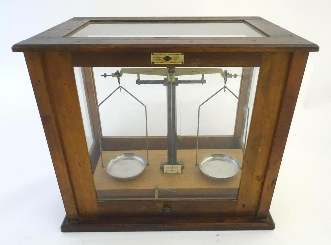 A set of vintage laboratory balance scales by W&J