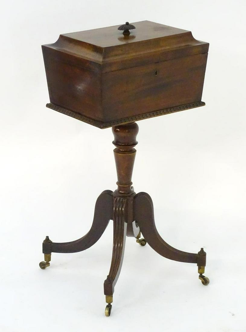 A Regency mahogany tea caddy on stand, with a
