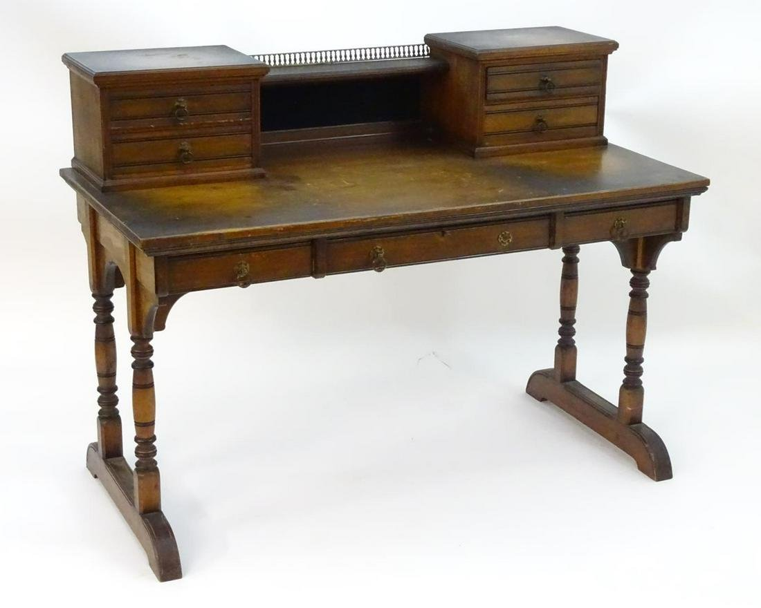 A late 19thC Aesthetic movement desk by Gillows of