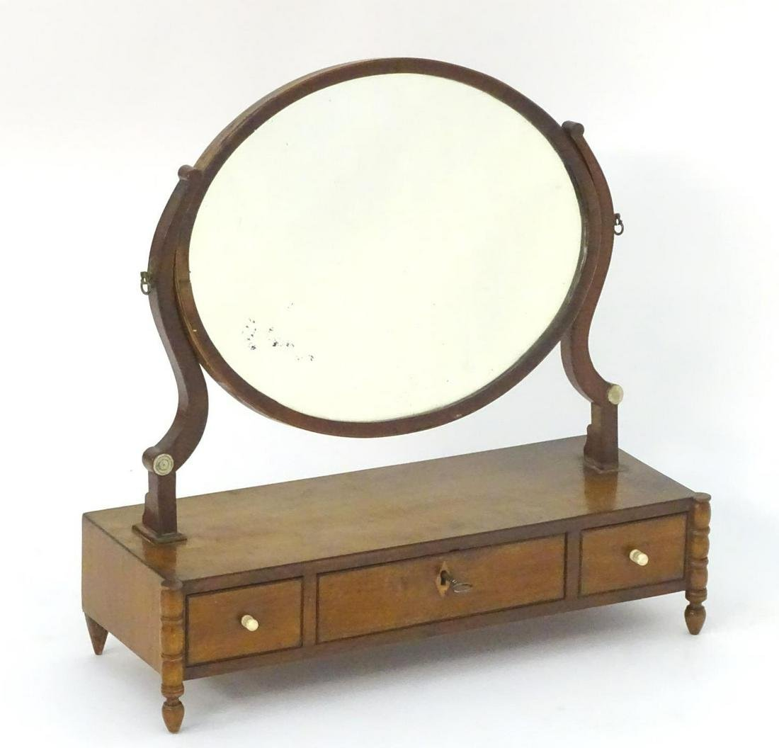 An early 19thC mahogany dressing table mirror, with an