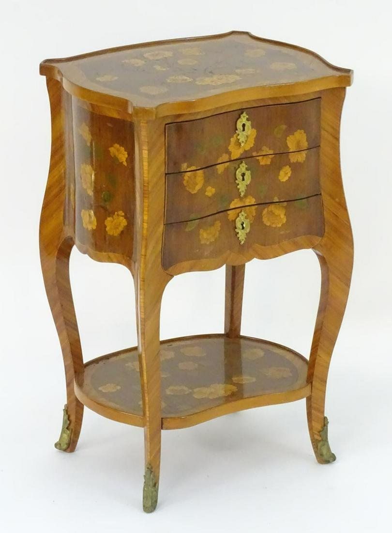 A 19thC satinwood ladies writing table with a shaped