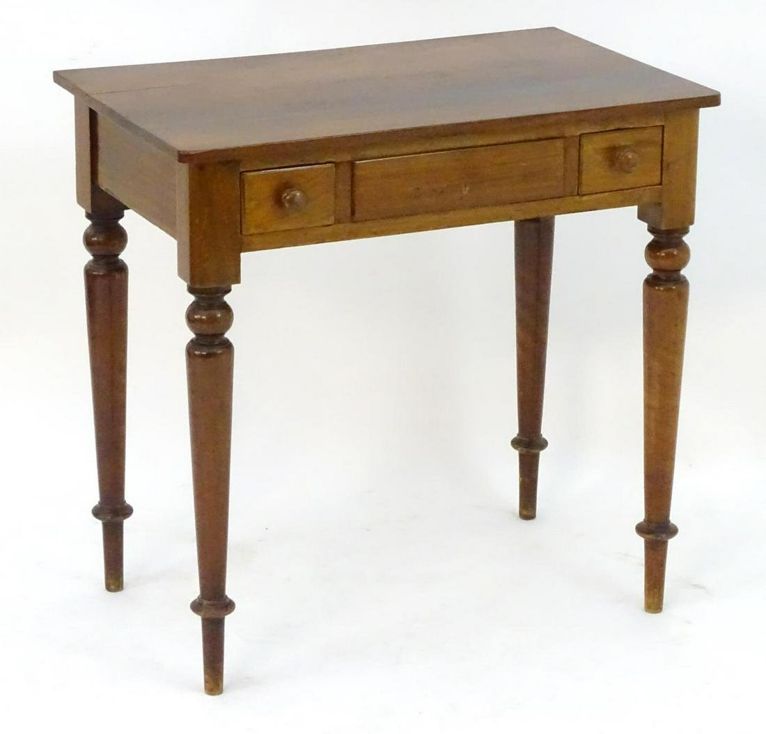 A late 19thC mahogany table with a rectangular top with