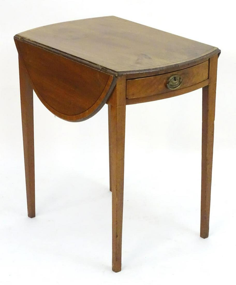 An early 19thC mahogany pembroke table with drop flaps