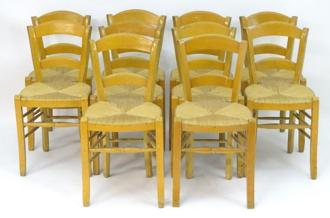 A set of ten chairs of beech construction with envelope