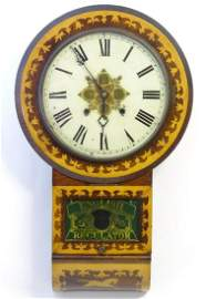 An American early 20thC 8-day drop dial wall clock, the