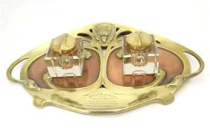 An Art Nouveau decorative metalware brass and copper