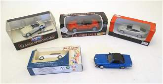 Toys: Four assorted boxed die cast scale models cars to
