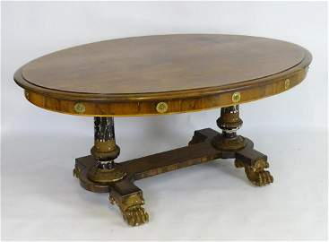 A Regency double pedestal table in the style of George