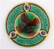 A Victorian majolica plate with roundel detail and