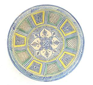A Moroccan earthenware dish decorated with a stylised