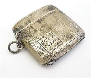 A silver vesta case with banded engine turned
