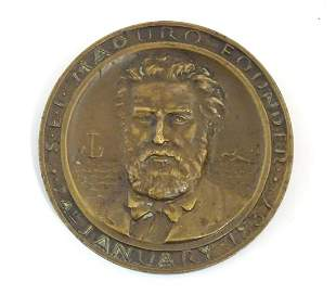 A 20thC bronze medallion commemorating the First