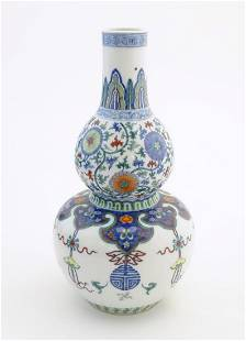 A Chinese double gourd vase with doucai style