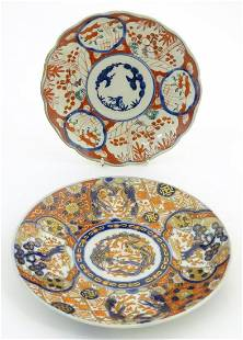 Two Oriental plates, one decorated with panelled detail