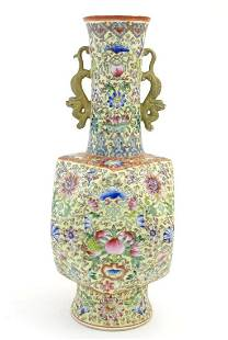 A Chinese famille jaune vase with twin handles modelled