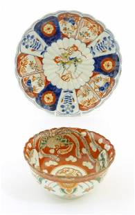 An Oriental plate in the Imari palette decorated with