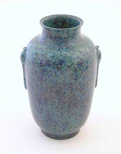 A Chinese vase with moulded twin handles and speckled