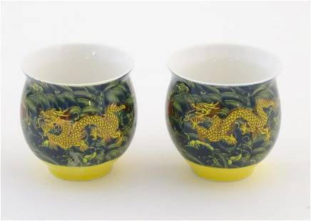 Two Chinese tea bowls of bulbous form with flared rims,