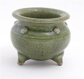 A Chinese three footed censor with a crackle glaze and