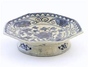 An Oriental blue and white footed dish, the octagonal