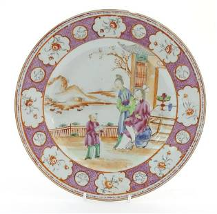 A Chinese famille rose plate depicting figures on a