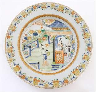 A Chinese plate depicting two ladies in a garden