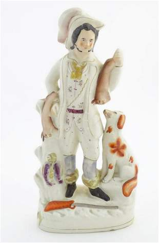 A Staffordshire pottery huntsman with a seated dog, and