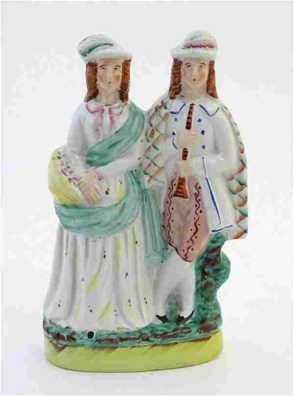 A Staffordshire pottery figural group depicting two