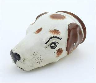 A Victorian Staffordshire pottery stirrup cup formed as