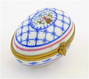A Limoges hand painted trinket box of egg form with